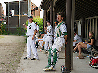 The Sunapee baseball team watches from the dugout as their team mates round the bases during Division IV semi final action with Colebrook Wednesday evening at Plymouth State University.  (Karen Bobotas/for Valley News)