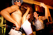 A topless man dancing with two girls, Clubbing UK 2000's