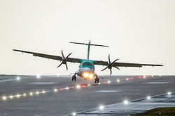 © Licensed to London News Pictures. 13/03/2019. Leeds UK. An Aer Lingus aircraft struggles to land in very strong cross winds at Leeds Bradford airport in Yorkshire this morning as storm Gareth hits the UK. Photo credit: Andrew McCaren/LNP