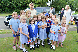 HRH the Countess of Wessex visits the Riverhill Regeneration project in Cobham Surrey on 9th July 2014.<br /> Picture shows:-The COUNTESS OF WESSEX and local school children