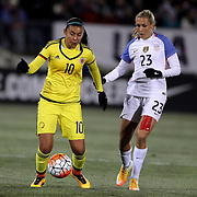 Yoreli Rincón, (left), Colombia, is challenged by Allie Long, USA,  during the USA Vs Colombia, Women's International friendly football match at the Pratt & Whitney Stadium, East Hartford, Connecticut, USA. 6th April 2016. Photo Tim Clayton