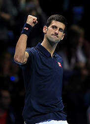 Novak Djokovic celebrates winning his match against David Goffin during day five of the Barclays ATP World Tour Finals at The O2, London.