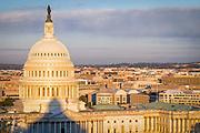 USA, Washington, DC. Sunrise over the U.S. Capitol and Northwest Washington.