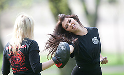 Krav Maga Instructor Michelle Gallacher takes Nieve Jennings through some Krav Maga techniques to promote the new Women Only Krav Maga classes  starting on 14th April, at LA Fitness, 89 Oswald Street, Glasgow. FREE PIC IF USED FOR ARTICLE ON THE WOMAN ONLY KRAV MAGA CLASS..©2011 Michael Schofield. All Rights Reserved..