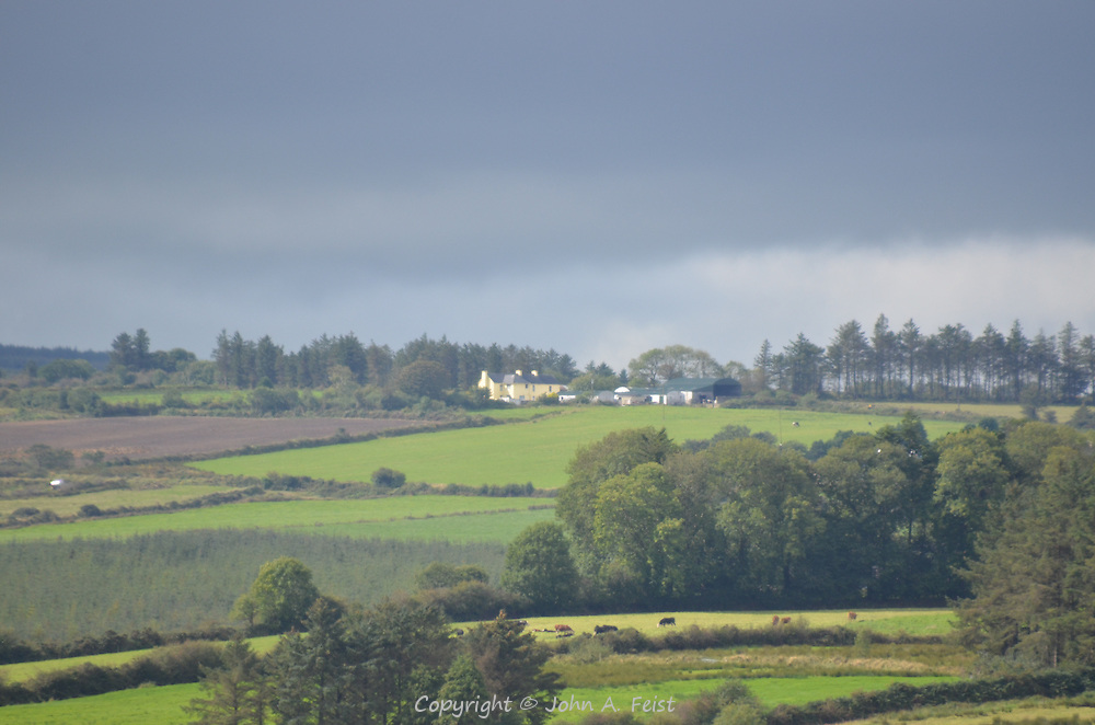 Threatening skies overhead looking out at the farms surrounding St Carthage Church, Brosna, County Kerry, Ireland