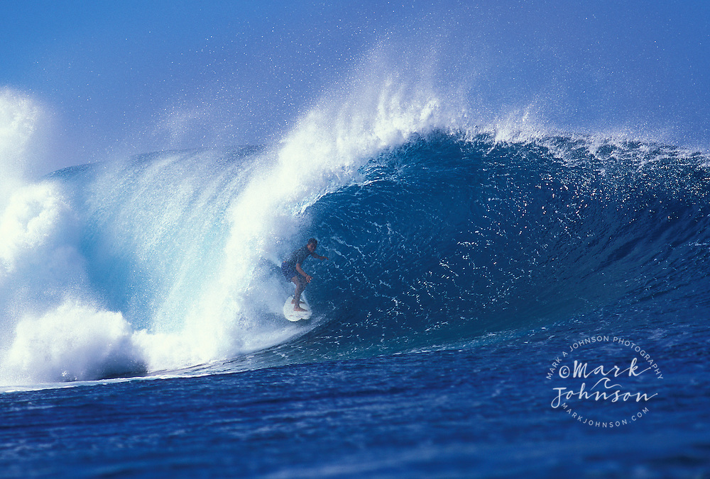 Surfer in tube, Pipeline, North Shore, Oahu, Hawaii.