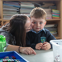 David Dutfield gets a goodbye kiss from his mammy Margaret on his first day at school at Liscannor