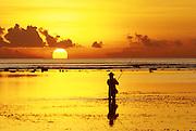 Sunrise with fisherman, at Sanur Beach.