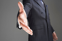 Businessman Offering Hand mid-section