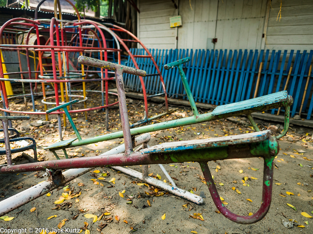 08 APRIL 2016 - BANGKOK, THAILAND:  An old playground for children who live in Mahakan Fort. The community is known for fireworks, fighting cocks and bird cages. Mahakan Fort was built in 1783 during the reign of Siamese King Rama I. It was one of 14 fortresses designed to protect Bangkok from foreign invaders, and only of two remaining, the others have been torn down. A community developed in the fort when people started building houses and moving into it during the reign of King Rama V (1868-1910). The land was expropriated by Bangkok city government in 1992, but the people living in the fort refused to move. In 2004 courts ruled against the residents and said the city could take the land. The final eviction notices were posted last week and the residents given until April 30 to move out. After that their homes, some of which are nearly 200 years old, will be destroyed.    PHOTO BY JACK KURTZ