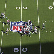 A general overhead view of action showing Jets Quarterback Geno Smith and the NFL logo and field markings during the New York Jets V New England Patriots NFL regular season game at MetLife Stadium, East Rutherford, NJ, USA. 20th October 2013. Photo Tim Clayton