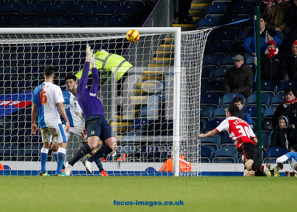 Picture by Michael Sedgwick/Focus Images Ltd +44 7900 363072<br /> 11/01/2014<br /> Paul Robinson of Blackburn Rovers saves a last minute effort by Alex Peterson of Doncaster Rovers during the Sky Bet Championship match at Ewood Park, Blackburn.