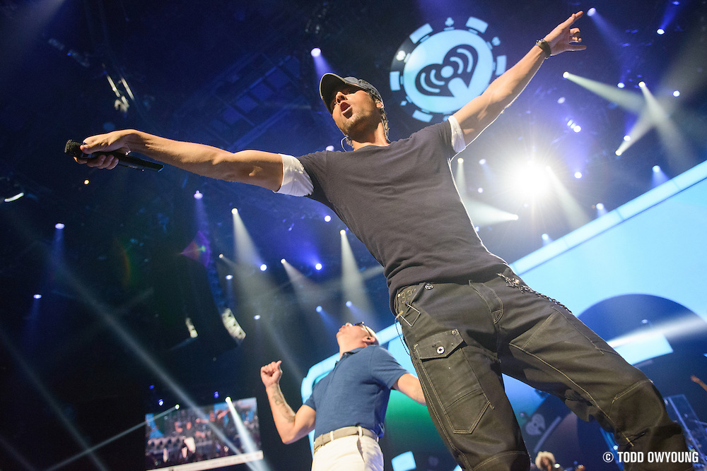 Enrique Inglesias and Pitbull performing at the iHeartRadio Music Festival in Las Vegas, Nevada on September 22, 2012.