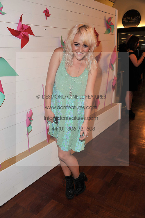 JAIME WINSTONE at a party to celebrate the launch of the Lucy in Disguise Ready to Wear collection exclusive to Harvey Nichols, held at The Fifth Floor Restaurant, Harvey Nichols, Knightsbridge, London on 25th May 2011.