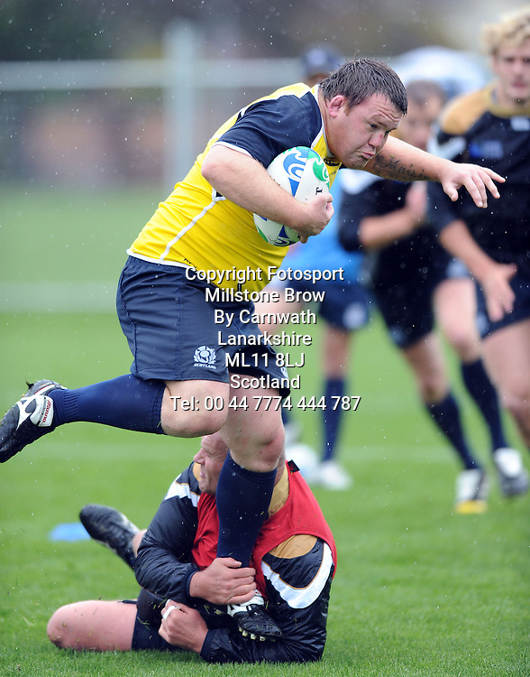Scotland prop Allan Jacobsen ginferly skips out of Geoff Cross' tackle.<br /> Scotland rugby team, open training session, Hutt Old Boys Marist RFC, Rugby World Cup, Wellington, New Zealand, Sunday 18th September 2011<br /> PLEASE CREDIT ***FOTOSPORT/DAVID GIBSON***