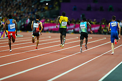 London, 2017-August-04. The field thunders down the track in the Men's 100m heat won by Usain Bolt, centre, track at the IAAF World Championships London 2017. Paul Davey.