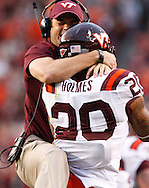 Associate head coach Shane Beamer of the Virginia Tech Hokies celebrates with running back Michael Holmes #20 after his touchdown run against the Cincinnati Bearcats at FedExField on September 29, 2012 in Landover, Maryland.