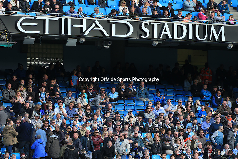 21st March 2015 - Barclays Premier League - Manchester City v West Bromwich Albion - Fans walkout as they leave empty seats at the Etihad Stadium - Photo: Simon Stacpoole / Offside.