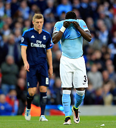 Bacary Sagna of Manchester City holds his shirt over his face - Mandatory by-line: Matt McNulty/JMP - 26/04/2016 - FOOTBALL - Etihad Stadium - Manchester, England - Manchester City v Real Madrid - UEFA Champions League Semi Final First Leg