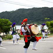 OKINAWA, JAPAN - AUGUST 17 : Local Eisa folk dancers perform a modern Eisa folk dance in a small village in Nago during the Obon festival to honour the spirits of their ancestors on August 17, 2016, Okinawa prefecture, Japan.  (Photo by Richard Atrero de Guzman/NURPhoto)