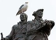 A gull perches atop a statue of Lewis and Clark, which commemorates the end of their trail across America, 1805-1806, at the present-day Prom at Seaside, Oregon, USA.