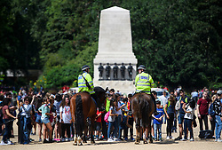 © Licensed to London News Pictures. 16/07/2016. London, UK. Mounted police watch over a parade on Horseguards Parade in Westminster, London two days after more than 80 people were killed in a terrorist attack in Nice, southern France. Photo credit: Ben Cawthra/LNP