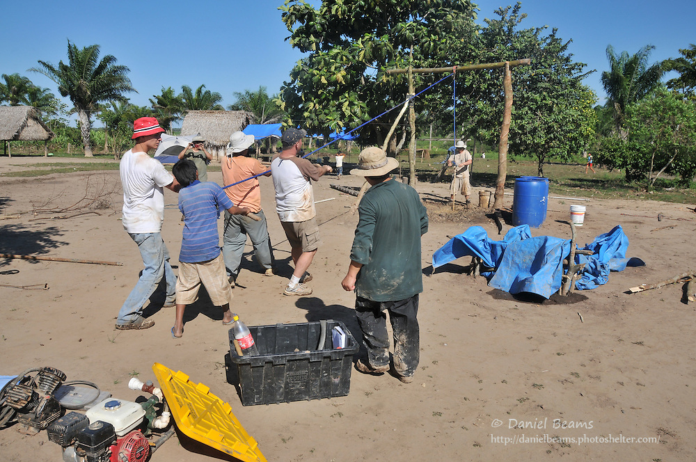 Volunteer team drilling a water well by hand in Villa Hermosa, Beni, Bolivia
