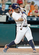 Jun 22, 2016; Houston, TX, USA; Houston Astros designated hitter Jose Altuve (27) hits a home run against the Los Angeles Angels in the sixth inning at Minute Maid Park. Mandatory Credit: Thomas B. Shea-USA TODAY Sports