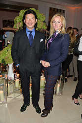 WEI KOH and SARAH ANN MURRAY group fashion editor of The Rake at a reception hosted by Wei Koh founder of The Rake Magazine and Thomas Kochs General Manager of Claridge's to celebrate London Collections: Man 2014 at Claridge's, Brook Street, London on 5th January 2014.