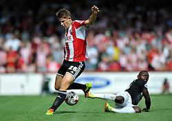 Brentford's James Tarkowski and Charlton Athletic's Igor Vetokele - Photo mandatory by-line: Patrick Khachfe/JMP - Mobile: 07966 386802 09/08/2014 - SPORT - FOOTBALL - Brentford - Griffin Park - Brentford v Charlton Athletic - Sky Bet Championship - First game of the season