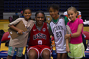 Asjha Jones posses with some loyal UConn fans after the 2012 USA Women's Basketball team practice at Bender Arena  in Washington, DC.  July 15, 2012  (Photo by Mark W. Sutton)