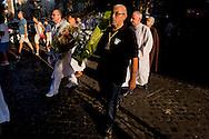 """Roma 25 Luglio 2015<br /> Le Confraternite della Corsica, della Diocesi di Ajaccio, con una cerimonia religiosa nella chiesa di S. Crisogono a Trastevere  hanno onorato la Madonna de Noantri, trovata da alcuni pescatori corsi nel 1535 alla foce del Tevere, e ricordato la Guardia còrsa papale, che nell'anno 1603,  il papa Clemente VIII arruolò in Corsica 600 fanti,  con funzioni di guardia del pontefice e di milizia urbana a Roma. I corsi si concentrarono sull'isola Tiberina e in Trastevere, dove la chiesa di San Crisogono fu """"titolo nazionale"""" e basilica cimiteriale dei còrsi. Le confraternite  in processione verso Ponte Garibaldi dove lanceranno i fiori nel Tevere in oore della Madonna del Carmine.<br /> Rome 25 July 2015<br /> The brotherhoods of Corsica, the Diocese of Ajaccio, with a religious ceremony in the church of S. Crisogono in Trastevere have honored Our Lady Noantri, found by some fishermen courses in 1535 at the mouth of the Tiber, and recalled the Corsican Guard  was a military unit of the Papal States composed exclusively of Corsican mercenaries on duty in Rome, having the functions of an urban militia and guard for the Pope.The Corsican Guard was formally founded in 1603 under Pope Clement VIII. The courses of 16th century, they concentrated on Tiber Island and in the part of Trastevere lying between the harbour of Ripa Grande and the church of San Crisogono San Crisogono became the national church and cemetery basilica of the Corsican nation in Rome, and over the centuries was used as burial place of several Corsican military officers. The brotherhoods in procession toward Ponte Garibaldi where will throw flowers into the Tiber in honor of the Madonna del Carmine."""