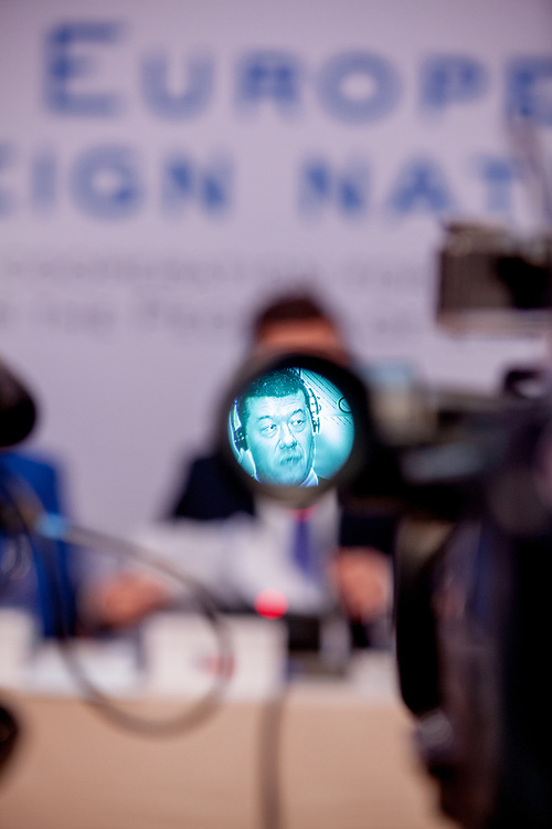 """Tomio Okamura seen through the viewfinder of a television camera during the press conference of the European anti-migrant parties """"Europe of Nations and Freedom"""" (ENF) in Prague. Attending were Marie Le Pen from France, Geert Wilders from Holland and Tomio Okamura of the Freedom and Direct Democracy (SPD) movement from Czech Republic which was hosting the meeting. Prague, 16.12.2017"""