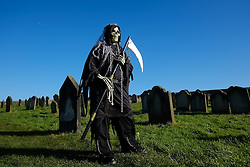 © Licensed to London News Pictures. <br /> 01/11/2014. <br /> <br /> Whitby, Yorkshire, United Kingdom<br /> <br /> Gav Woodward from Middlesbrough comes to the Whitby Goth Weekend dressed as the grim reaper. <br /> <br /> The event this weekend brings together thousands of extravagantly dressed followers of Victoriana, Steampunk, Cybergoth and Romanticism who all visit the town to take part in celebrating Gothic culture. This weekend marks the 20th anniversary since the event was started by local woman Jo Hampshire.<br /> <br /> Photo credit : Ian Forsyth/LNP
