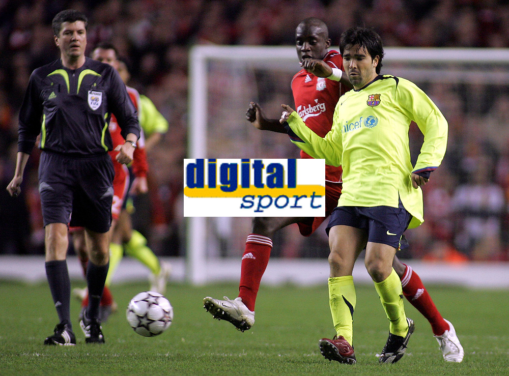Photo: Paul Thomas.<br /> Liverpool v Barcelona. UEFA Champions League. Last 16, 2nd Leg. 06/03/2007.<br /> <br /> Mohamed Sissoko (Red) of Liverpool tries to tackle Deco.