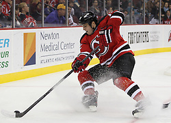 Oct 21; Newark, NJ, USA; New Jersey Devils right wing Nick Palmieri (12) skates with the puck during the second period of their game against the San Jose Sharks at the Prudential Center.