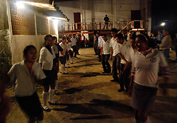 "MEXICO, Veracruz, Tantoyuca, Oct 27- Nov 4, 2009. Night ""cuadrillo"" practice behind the Tantoyuca dance studio of Marcelo Rodriguez Ordaz. ""Xantolo,"" the Nahuatl word for ""Santos,"" or holy, marks a week-long period during which the whole Huasteca region of northern Veracruz state prepares for ""Dia de los Muertos,"" the Day of the Dead. For children on the nights of October 31st and adults on November 1st, there is costumed dancing in the streets, and a carnival atmosphere, while Mexican families also honor the yearly return of the souls of their relatives at home and in the graveyards, with flower-bedecked altars and the foods their loved ones preferred in life. Photographs for HOY by Jay Dunn."