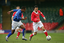 CARDIFF, WALES - WEDNESDAY, MARCH 1st, 2006: Wales' Ryan Giggs and Paraguay's Paulo da Silva during the International Friendly match at the Millennium Stadium. (Pic by Dan Istitene/Propaganda)