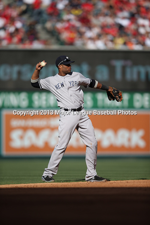 ANAHEIM, CA - JUNE 15:  Robinson Cano #24 of the New York Yankees throws the ball to first base during the game against the Los Angeles Angels of Anaheim on Saturday, June 15, 2013 at Angel Stadium in Anaheim, California. The Angels won the game 6-2. (Photo by Paul Spinelli/MLB Photos via Getty Images) *** Local Caption *** Robinson Cano