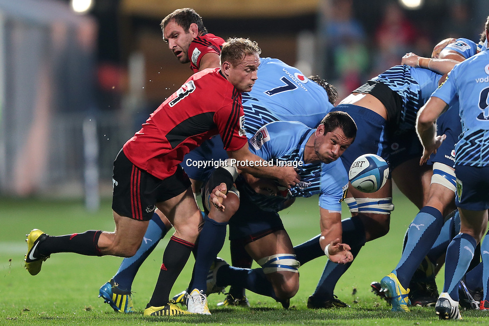 Pierre Spies of the Bulls is tackled by Andy Ellis of the Crusaders during the Super Rugby match between the Crusaders and the Bulls at AMI Stadium on Saturday March 15, 2013 in Christchurch, New Zealand. Photo: Martin Hunter/Photosport