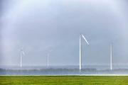 Wind turbines into the fog