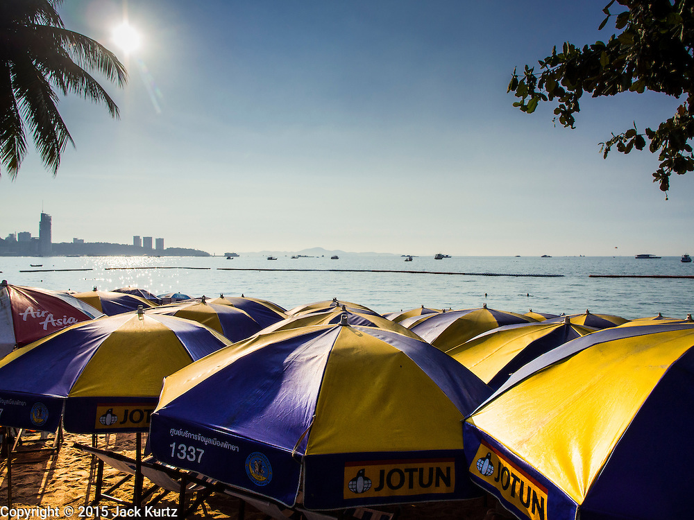 06 JANUARY 2015 - PATTAYA, CHONBURI, THAILAND: Beach umbrellas line Pattaya beach. The Thai government has announced plans to clean up Pattaya beach, one of the most famous beaches in Thailand. Pattaya is about 2.5 hours from Bangkok. They plan to reduce the number of umbrella and chaise lounge vendors on the beach and regulate the personal watercraft and parasailing vendors on the beach. The government has already cleaned up beaches on Phuket island and Hua Hin.    PHOTO BY JACK KURTZ