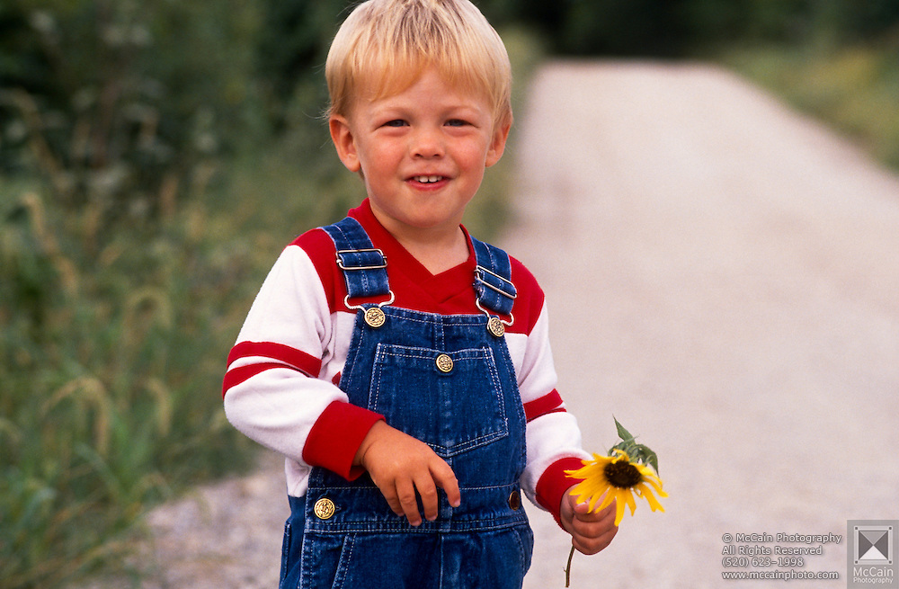 Morten Sunnarvik holding a sunflower.©1988 Edward McCain. All rights reserved. McCain Photography, McCain Creative, Inc.