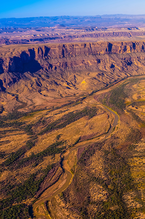 Aerial view taken over Big Bend National Park, Texas USA looking to the Rio Grande River, which is the border between the U.S. and Mexico. Mexico is on the left side of the river.