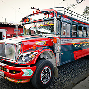 A brightly painted chicken bus on the street in Antigua, Guatemala.