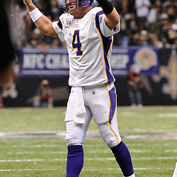 Jan 24, 2010; New Orleans, LA, USA; Minnesota Vikings quarterback Brett Favre (4) celebrates after throwing a touchdown during a 31-28 overtime victory by the New Orleans Saints over the Minnesota Vikings in the 2010 NFC Championship game at the Louisiana Superdome. Mandatory Credit: Derick E. Hingle-US PRESSWIRE