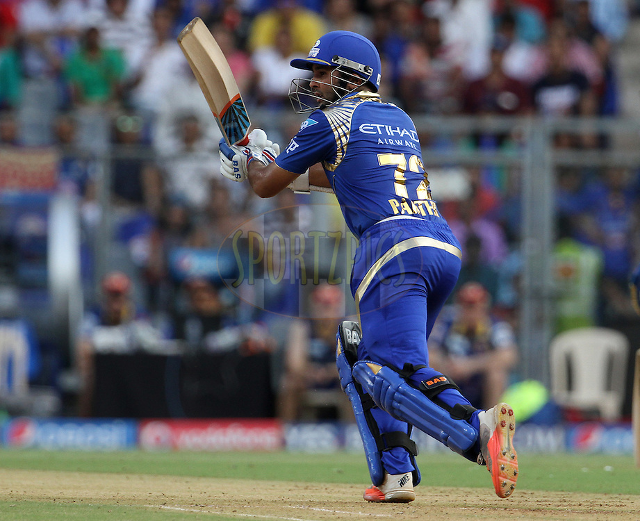 Mumbai Indians player Parthiv Patel plays a shot during match 46 of the Pepsi IPL 2015 (Indian Premier League) between The Mumbai Indians and The Royal Challengers Bangalore held at the Wankhede Stadium in Mumbai, India on the 10th May 2015.<br /> <br /> Photo by:  Vipin Pawar / SPORTZPICS / IPL