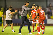 Gabriele Cioffi, Head Coach of Crawley Town FC celebrates the win for Crawley with Beryly Lubula (Crawley Town) following the EFL Cup match between Crawley Town and Norwich City at The People's Pension Stadium, Crawley, England on 27 August 2019.