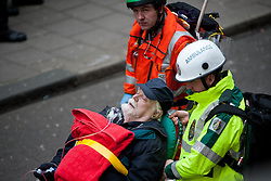© licensed to London News Pictures.  London, UK. 22/02/12. Emergency services evacuate mock casualty. 'Exercise Forward Defensive' olympic emergency training simulation takes place at the closed Aldywch underground station, Surrey Street, Westminster. Photo © Jules Mattsson