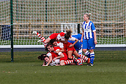 The Charlton players celebrate during the FA Women's Premier League Cup quarter-final match between Brighton Ladies and Charlton Athletic WFC at The American Express Elite Football Performance Centre, Lancing, United Kingdom on 1 March 2015. Photo by Geoff Penn.